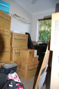 Somewhere among those boxes is my desk!