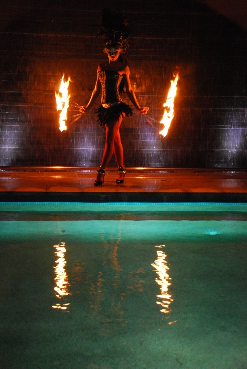 A fire-twirler, part of the great entertainment provided by Tourism & Events Queensland.