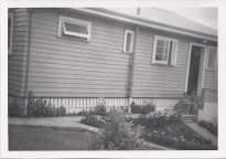 Sitting on the steps of the house that Dad built. I'm the little one. Circa 1962.