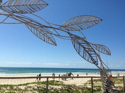 Paradise - Girt By Sea, by Jules Hunt (NSW). Part of an archway of steel, copper and aluminium leaves.