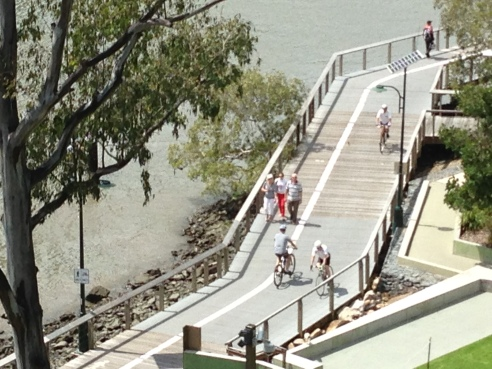 Boardwalk riders alongside the Brisbane River, Australia.
