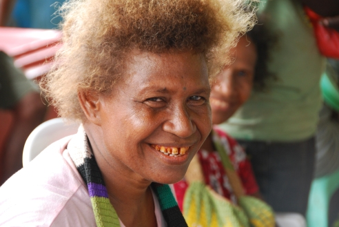 A betel-nut smile from a woman selling fish at the Honiara Central Market.
